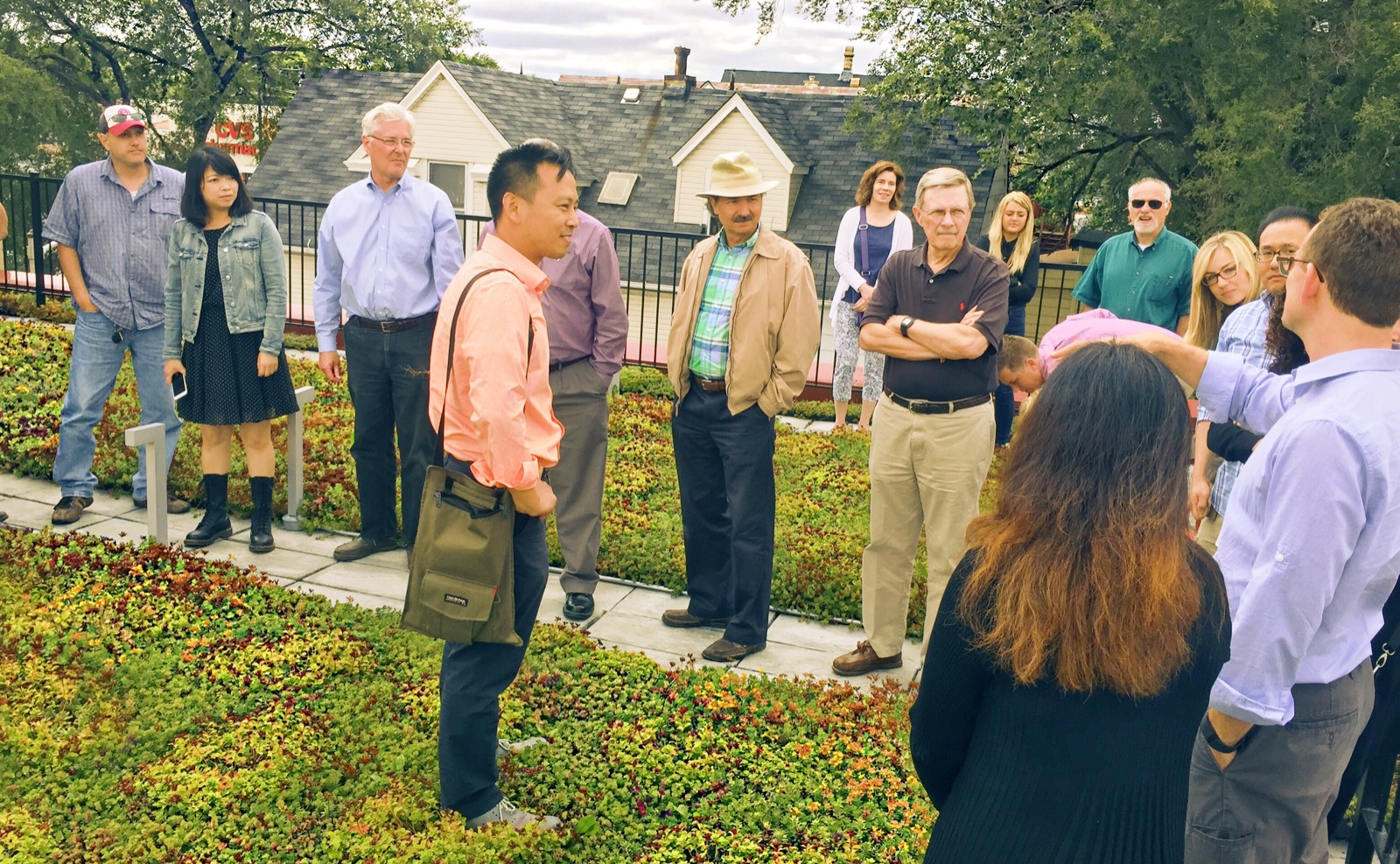 Touring the green roof with project architect, Richard Kasemsarn